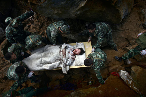 Rescue troops carry earthquake survivor, Beichuan County, China