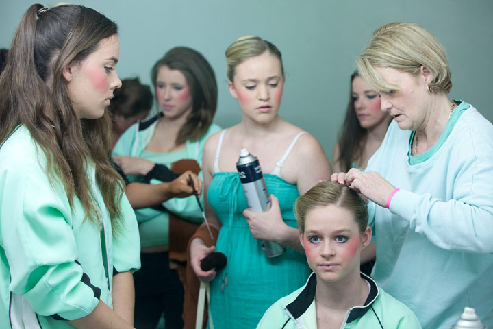 The grooming routine for teams in the 15–16 years section, Sydney Olympic Park, sees eight girls made up simultaneously. Lipstick always goes on at the last possible moment